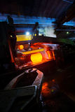 Producing steel in foundry. Shapening molten steel and making it solid before transporting to cooling-off procedure Stock Photos