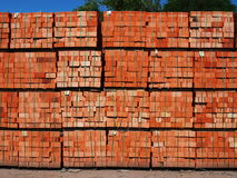 Product brickworks. Just made red bricks stacked in several rows for sale stock image