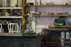 The product of a craftsman a crystal/glass horse in a work studio Stock Images