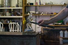 The product of a craftsman a crystal/glass horse in a work studio Royalty Free Stock Photography