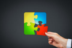 Product customization. Concept represented by customer collecting puzzle Stock Photo