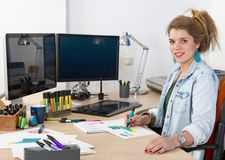 Product Designer. Young product designer drawing product sketches at her desk Stock Images