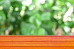 For product display. Empty top wooden table orange and leaves blurred background, Can use for product display Royalty Free Stock Photography