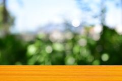 For product display. Empty top wooden table orange and leaves blurred background, Can use for product display Stock Photos