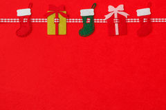 The product of felt. Christmas theme on a red felt royalty free stock image