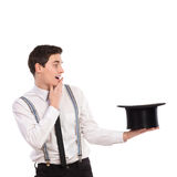 Product jumping out from magicians top hat. Royalty Free Stock Photo