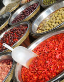 Product of lands of southern Italy with olives and red peppers w Royalty Free Stock Image