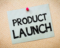 Product Launch Message. Recycled paper note pinned on cork board. Product Launch Message.Businessl Concept Image Stock Photo