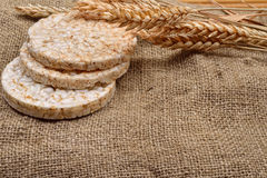Product made from wheat, expanded and ears wheat on o jute backg. Round. Healthy organic food. Selectiv focus. Copy space Stock Images