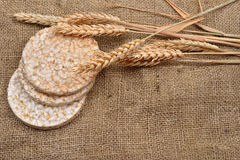 Product made from wheat, expanded and ears wheat on o jute backg. Round. Healthy organic food. Selectiv focus. Copy space Stock Photo