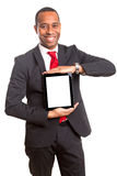 Product presentation. African business man presenting your product in a tablet computer stock photos