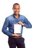 Product presentation. African business man presenting your product in a tablet computer royalty free stock photo