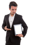Product presentation. Business man presenting your product in a tablet computer royalty free stock images