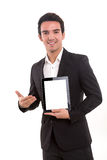 Product presentation. Business man presenting your product in a tablet computer stock photos