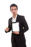Product presentation. Business man presenting your product in a tablet computer royalty free stock photo