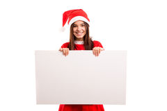 Product presentation. Sexy asian woman dressed as Santa Claus, presenting your product on a white board Royalty Free Stock Photo