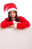 Product presentation. Sexy asian woman dressed as Santa Claus, presenting your product on a white board Stock Image