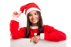 Product presentation. Sexy asian woman dressed as Santa Claus, presenting your product on a white board Royalty Free Stock Photos