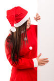 Product presentation. Sexy asian woman dressed as Santa Claus, presenting your product on a white board Stock Images