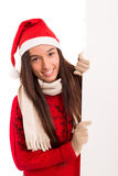 Product presentation. Sexy asian woman dressed as Santa Claus, presenting your product on a white board Stock Photo