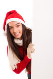 Product presentation. Sexy asian woman dressed as Santa Claus, presenting your product on a white board Stock Photos