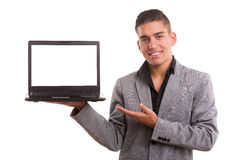 Product presentation. Young man presenting your product in a laptop computer Royalty Free Stock Image