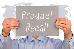 Product Recall - Manager with sign and text. On world map background stock images