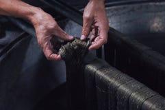 Productie en het weven van tapijten en stoffen Stock Foto