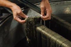 Productie en het weven van tapijten en stoffen Stock Foto's
