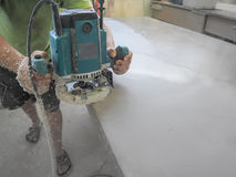 The production of acrylic worktops at a furniture factory. A worker produces acrylic countertops at the factory. A worker polishes Royalty Free Stock Photos