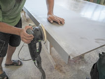 The production of acrylic worktops at a furniture factory. A worker produces acrylic countertops at the factory. A worker polishes Stock Image