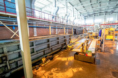 Production of aerated concrete blocks at factory production facilities. Production of aerated concrete blocks at bright new factory production facilities ready Royalty Free Stock Photo