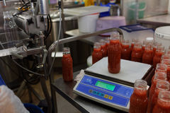 Production of ajika sauce in a food processing plant. St. Petersburg, Russia - February 28, 2017: Production of ajika sauce in a food processing plant. The stock photos