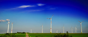 Production of alternative energy, solar panels and wind generators. Panoramic image Stock Image