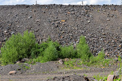 Production area with road and rocks.  stock photography
