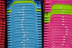 Production of Asia - Plastic Chairs. Close-up of bright and colorful child plastic chairs produced in Thailand stock photos