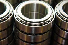 Production of bearings. Steel factory production line of the machine stock photos