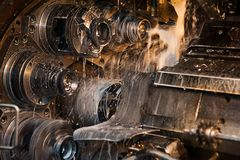 Production of bearings. Steel factory production line of the machine royalty free stock photos