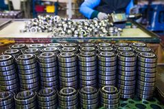 Production of bearings. Steel factory production line of the machine royalty free stock photo