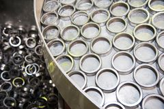 Production of bearings. Steel factory production line of the machine royalty free stock photography