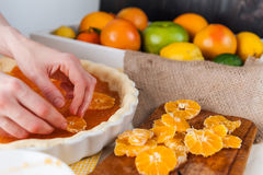 Production of cake with citrus Royalty Free Stock Images