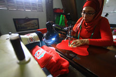 Production of cars and stuffed pillows. Tailor finish stitching pattern pillow car in Solo, Central Java, Indonesia. Cottage industry manufacture cars and Royalty Free Stock Images