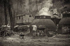 The production of charcoal in a traditional manner in the forest Royalty Free Stock Image