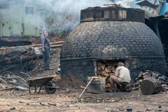 The production of charcoal in a traditional manner in the forest Royalty Free Stock Images