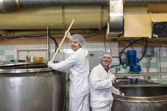Production of cheese in  dairy,  two worker Stock Photography