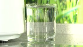 Production of clean water or alcohol. Table home or chemical laboratory Distiller for production of pure water. Close up. Production of clean water or alcohol stock footage