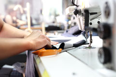 Production of clothes, sewing on a machine stock images