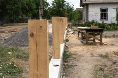 Concrete foundation for fence. Production of the concrete base for a wooden fence. Production of the concrete base for a wooden fence royalty free stock photos