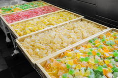 Production of confectionery. Sweet fresh colorful fruit candy at the confectionery factory waiting for their buyers Royalty Free Stock Images