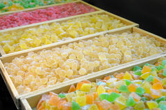 Production of confectionery. Sweet fresh colorful fruit candy at the confectionery factory waiting for their buyers stock photos